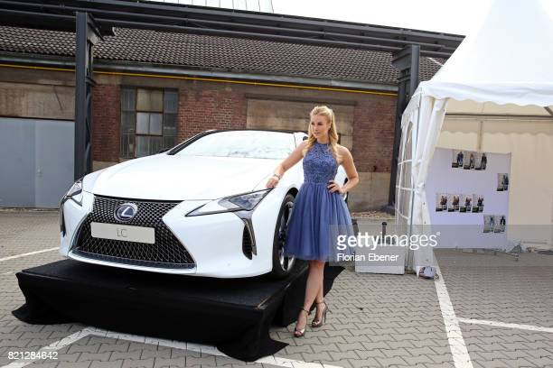 Nina Ensmann poses in front of a Lexus at the PF Selected show during Platform Fashion July 2017 at Areal Boehler on July 23 2017 in Duesseldorf...