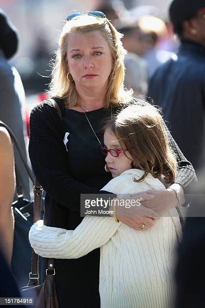 Nina Fisher sister of 9/11 victim Andrew Fisher embraces her niece Mia Tinson during ceremonies for the eleventh anniversary of the terrorist attacks...