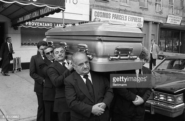 Nina Galante daughter of slain Mafia Don Carmine Galante is helped into car for trip to St John's cemetery July 16th where her father was buried in a...