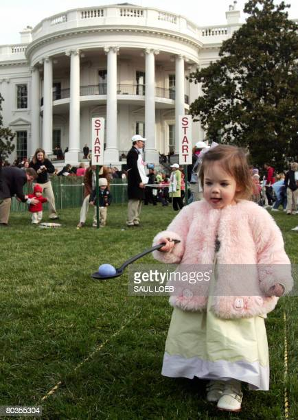 Nina Galbraith age 2 of Dallas Texas participates in the annual Easter Egg Roll on the South Lawn of the White House in Washington DC on March 24...