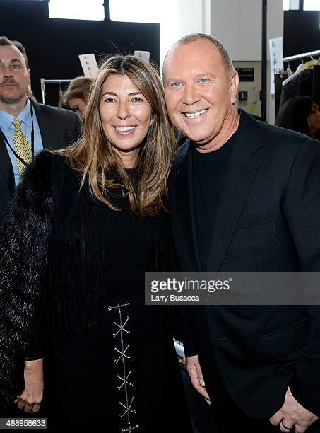 Nina Garcia and designer Michael Kors pose backstage at the Michael Kors fashion show during MercedesBenz Fashion Week Fall 2014 at Spring Studios on...