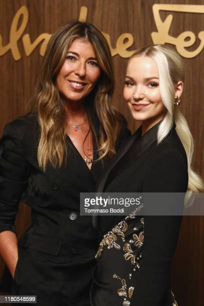 Nina Garcia and Dove Cameron attend the ELLE x Ferragamo Hollywood Rising Party at Sunset Tower on October 11, 2019 in Los Angeles, California.