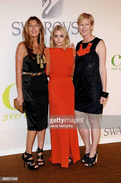 Nina Garcia Ashley Olsen and guest attend the 2009 CFDA Fashion Awards at Alice Tully Hall Lincoln Center on June 15 2009 in New York City
