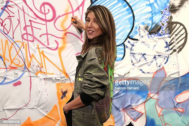 Nina Garcia Creative Director Marie Claire attends the Faith Connexion Street Art Tour hosted by Saks Fifth Avenue and Marie Claire at Saks Fifth...