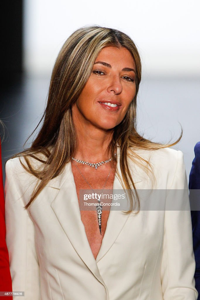 Nina Garcia greets the audience before presenting the Project Runway Season 14 fashion show at The Arc, Skylight at Moynihan Station on September 11, 2015 in New York City.