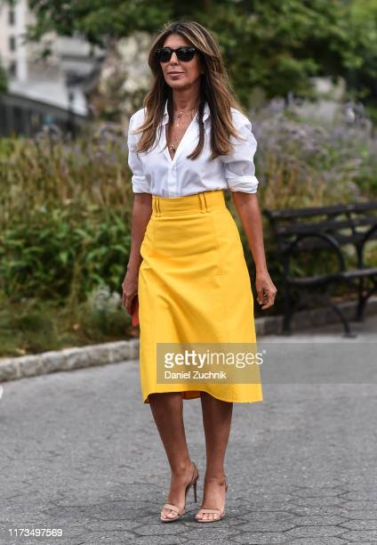 Nina Garcia is seen wearing a white top and yellow skirt outside the Carolina Herrera show during New York Fashion Week S/S20 on September 09 2019 in...