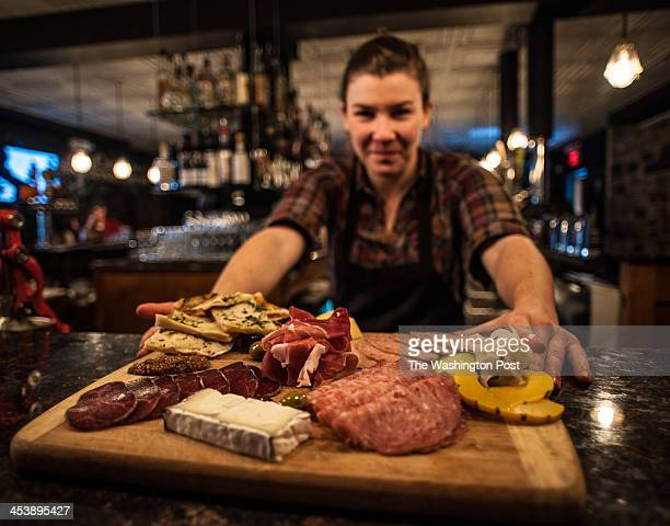 Nina Graham displays a charcuterie board of cured meats and cheeses Birroteca has been open in the Mill Corridor near Hampden for about a year and a...