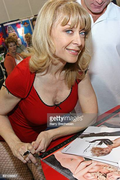 Nina Hartley signing at the Adam Eve booth