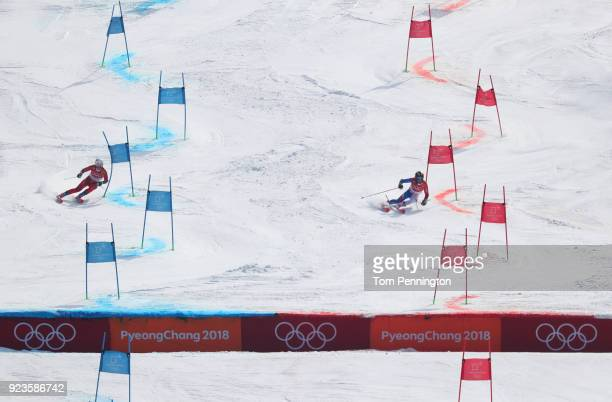 Nina HaverLoeseth of Norway and Adeline Baud Mugnier of France compete during the Alpine Team Event Small Final on day 15 of the PyeongChang 2018...