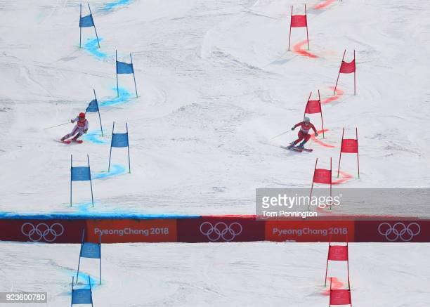 Nina Haver-Loeseth of Norway and Katharina Gallhuber of Austria compete during the Alpine Team Event Semifinals on day 15 of the PyeongChang 2018...