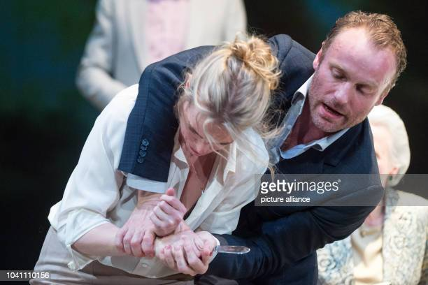 Nina Hoss and Mark Waschke perform on stage during the photo rehearsal of the play 'Bella Figura' in the theatre at the Lehniner square in Berlin...