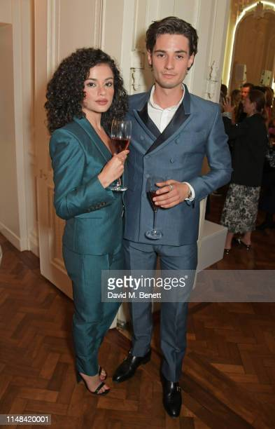 Nina Hosseinzadeh and Jack Brett Anderson attend the Moet Summer House opening night on June 6 2019 in London England