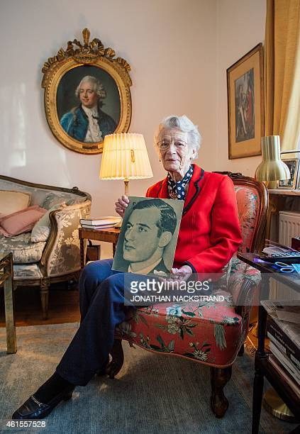 Nina Lagergren 93yearold halfsister of Raoul Wallenberg holds a picture of her brother at her apartment on January 13 2015 in Djursholm near...