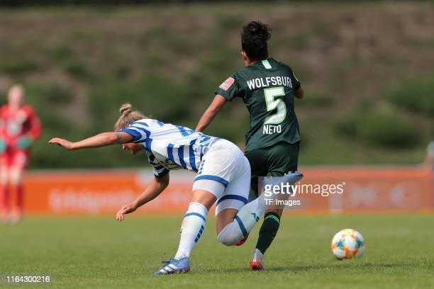 Nina Lange of MSV Duisburg and Claudia Neto of VfL Wolfsburg battle for the ball during the FLYERALARM Frauen Bundesliga match between MSV Duisburg...