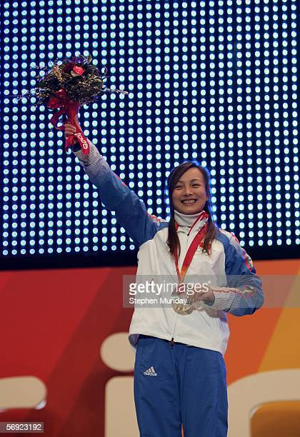 Nina Li of China receives the Silver Medal in the Womens Freestyle Skiing Aerials at the Medals Plaza on Day 13 of the 2006 Turin Winter Olympic...