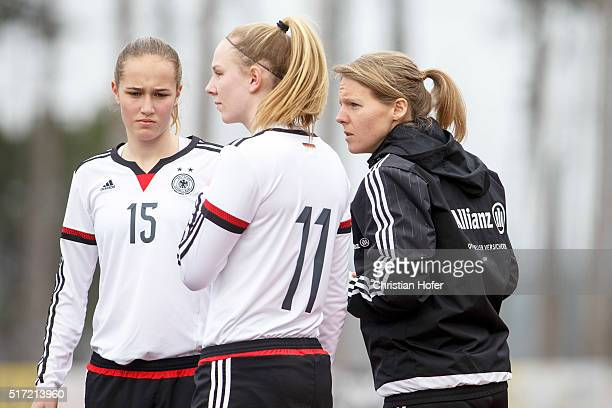 Nina Luehrssen Annalena Rieke and assistant coach Friederike Kromp look on during the U17 Girl's Euro Qualifier match between Germany and Switzerland...