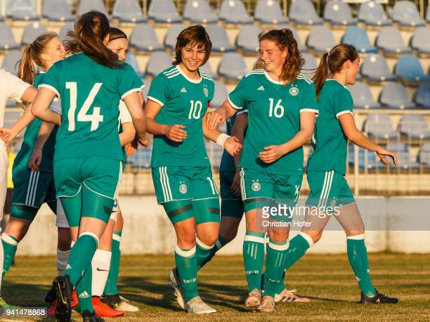 Nina Luehrssen Lena Sophie Oberdorf and Lisa Ebert of Germany celebrates after scoring during the UEFA Women's Under19 Elite Round match between...