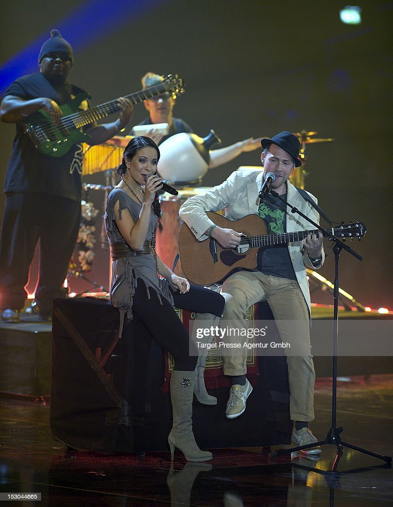 Nina Maleika and Mellow Mark perform during the 'Bundesvision Song Contest 2012' at the Max-Schmeling-Halle on September 28, 2012 in Berlin, Germany.