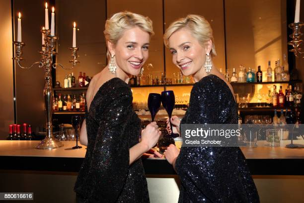 Nina Meise and her twin sister Julia Meise during the DressHeaven 2017 Christmas party by 'dresscoded' at Armani Caffe on November 27 2017 in Munich...
