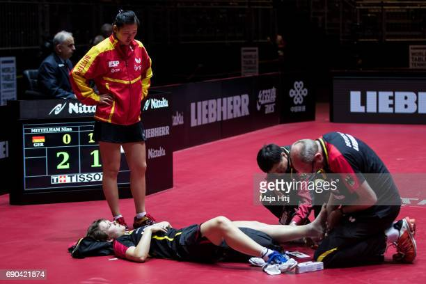 Nina Mittelham of Germany lies injured next to Maria Xiao of Spain during Women Single 1 Round at Table Tennis World Championship at Messe...