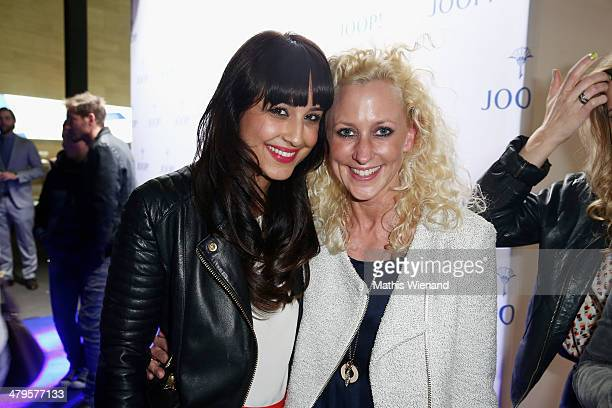 Nina Moghaddam and Guest attend the Joop Store Opening at Koe Bogen Dusseldorf on March 19 2014 in Dusseldorf Germany