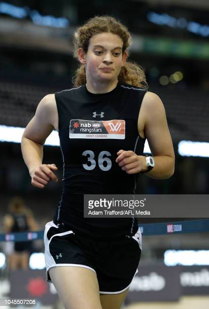 Nina Morrison performs in the 2km time trial which she was the winner of during the AFLW Draft Combine at Marvel Stadium on October 3 2018 in...