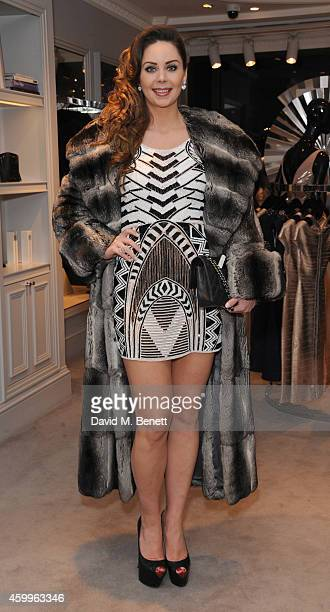 Nina Naustdal attends the Herve Leger Christmas Party on December 4 2014 in London England