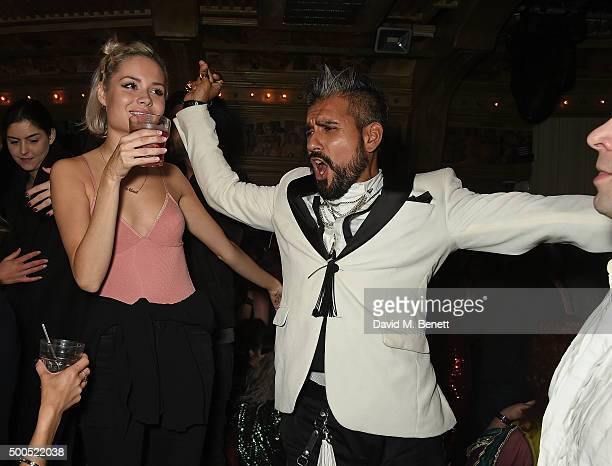 Nina Nesbitt and Azim Majid attend the Ibiza Rocks the Box Christmas Party at The Box Soho on December 8 2015 in London England