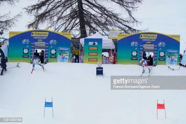 Nina O Brien of USA, Wendy Holdener of Switzerland compete during the FIS Alpine Ski World Championships Men's & Women's Parallel Giant Slalom on...
