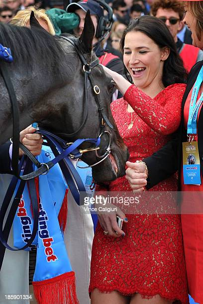 Nina O'Brien wife of trainer Danny gives Shamus Award a pat after winning race 10 the Sportingbet Cox Plate during Cox Plate Day at Moonee Valley...