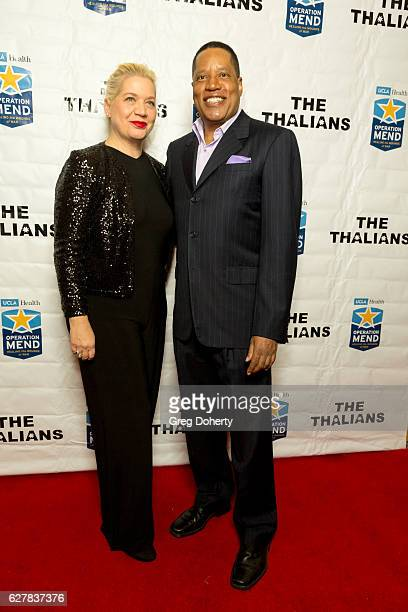 Nina Perry and Lawyer writer and radio and television personality Larry Elder arrives for The Thalians Presidents Club's Holiday Brunch Spectacular...