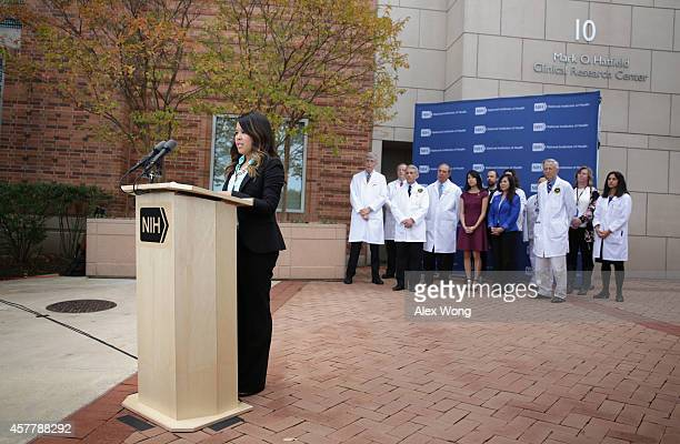 Nina Pham the nurse who was infected with Ebola from treating patient Thomas Eric Duncan speaks as Director of the National Institutes of Health...