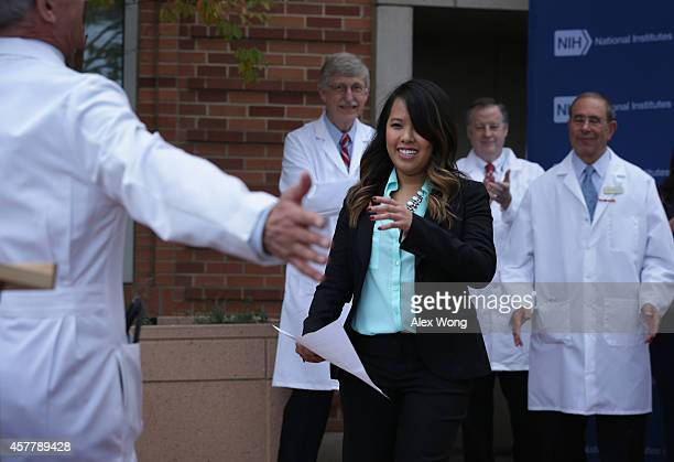 Nina Pham the nurse who was infected with Ebola from treating patient Thomas Eric Duncan is welcomed to the podium by Director of the National...