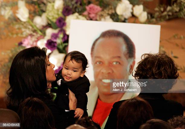 Nina Rawls, left, hugs her son, Aiden Rawls who are the widow and son of the late singer Lou Rawls, during a funeral service for musician Lou Rawls,...