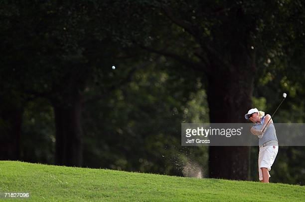 Nina Reis of Sweden hits her second shot from a fairway bunker on the eighteenth hole during the first round of the John Q Hammons Hotel Classic on...