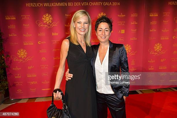 Nina Ruge and Dunja Hayali attend the VITA Charity Gala at the Kurhaus on October 11, 2014 in Wiesbaden, Germany.