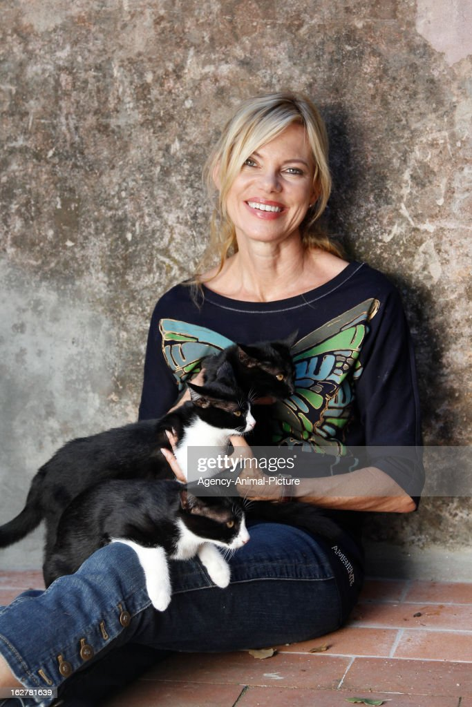 Nina Ruge and her cats on July 15, 2010 in Lucca, Italy.