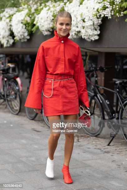 Nina Sandbech is seen on the street during Fashion Week Stockholm SS19 wearing red outfit with chain belt and red/white shoes on August 30 2018 in...