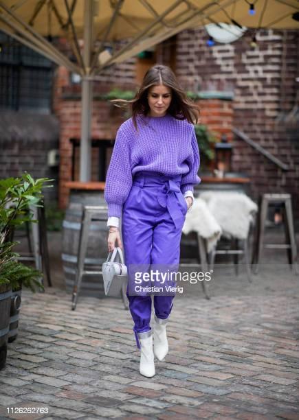 Nina Sandbech is seen wearing purple knit, high waist pants, Balenciaga bag, white ankle boots outside Holzweiler during the Copenhagen Fashion Week...