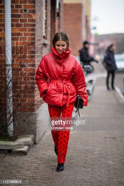 Nina Sandbech is seen wearing red coat pants with print outside Baum und Pferdgarten during the Copenhagen Fashion Week Autumn/Winter 2019 Day 3 on...