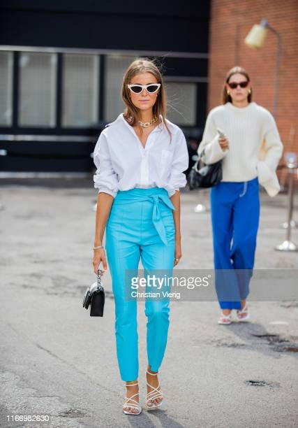 Nina Sandbech is seen wearing white button shirt turquoise pants outside By Malene Birger during Copenhagen Fashion Week Spring/Summer 2020 on August...