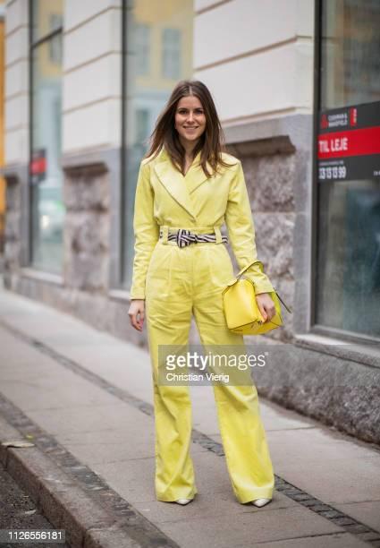 Nina Sandbech is seen wearing yellow pants blazer Loewe bag outside Hofmann Copenhagen during the Copenhagen Fashion Week Autumn/Winter 2019 Day 3 on...