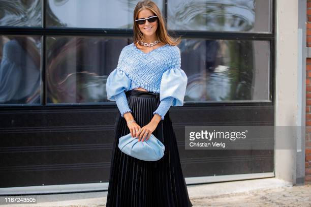 Nina Sandbech seen wearing blue blouse pleated mini skirt clutch outside Munthe during Copenhagen Fashion Week Spring/Summer 2020 on August 07 2019...