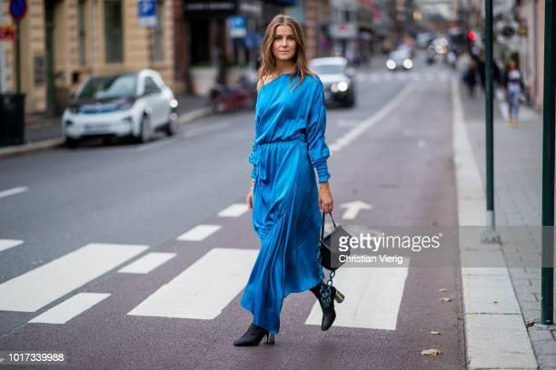 Nina Sandbech wearing blue dress seen outside Michael Olestad during Oslo Runway SS19 on August 15, 2018 in Oslo, Norway.