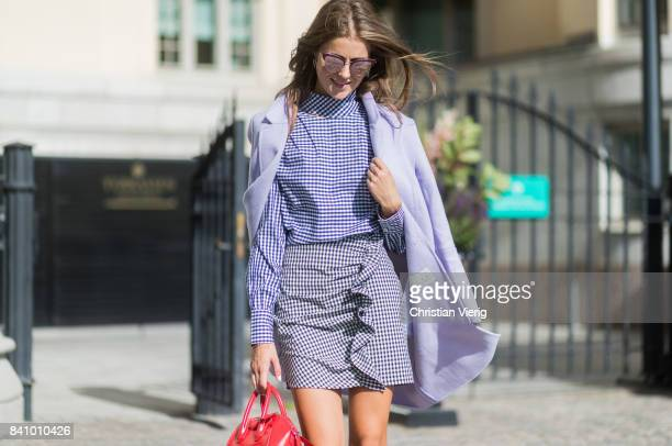 Nina Sandbech wearing checked blouse and skirt, red Givenchy bag outside Stylein on August 30, 2017 in Stockholm, Sweden.