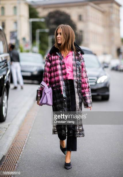 Nina Sandbech wearing checked coat during Stockholm Runway SS19 on August 30 2018 in Stockholm Sweden