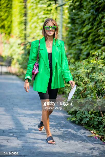 Nina Sandbech wearing green blazer jacket cycle pants is seen outside By Malene Birger during the Copenhagen Fashion Week Spring/Summer 2019 on...
