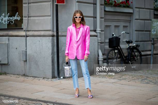 Nina Sandbech wearing pink blazer cropped denim jeans silver Paco Rabanne bag is seen during Stockholm Runway SS19 on August 29 2018 in Stockholm...