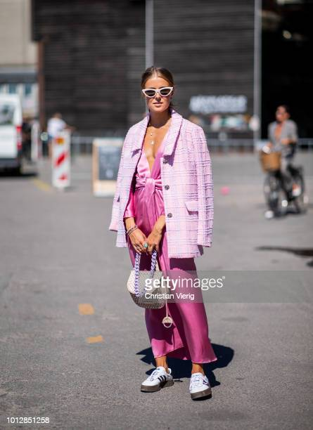 Nina Sandbech wearing pink Lupe dress pink jacket Celine sunglasses Cala Jade bag is seen outside Resume during the Copenhagen Fashion Week...