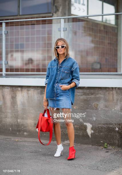 Nina Sandbech wearing red white two tone ankle boots denim skirt and button shirt is seen outside JLindeberg during the Copenhagen Fashion Week...